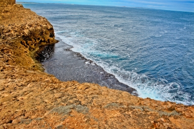Along with white sandy beaches, jagged rocky cliffs also dominate